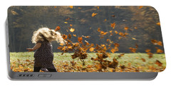 Portable Battery Charger featuring the photograph Whirling With Leaves by Carol Lynn Coronios