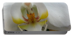 White And Yellow Orchid Portable Battery Charger by Caryl J Bohn
