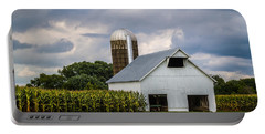 White Barn And Silo With Storm Clouds Portable Battery Charger