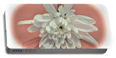 White Flower On Pale Coral Vignette Portable Battery Charger