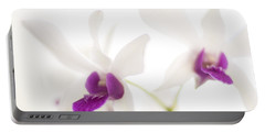 Portable Battery Charger featuring the photograph White Orchids by Bradley R Youngberg