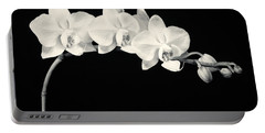 White Orchids Monochrome Portable Battery Charger by Adam Romanowicz