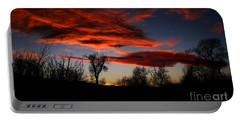 Portable Battery Charger featuring the photograph Wicked Skies by Janice Westerberg