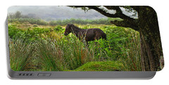 Portable Battery Charger featuring the photograph Wild Dartmoor Foal by Menega Sabidussi