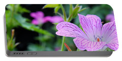 Portable Battery Charger featuring the photograph Wild Geranium Flowers by Clare Bevan