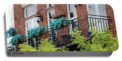 Blue Flowers On A Balcony  Portable Battery Charger