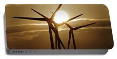 Wind Turbines Silhouette Against A Sunset Portable Battery Charger