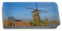 Windmills And Bridge Near Kinderdijk Portable Battery Charger by Frans Blok