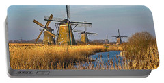 Windmills And Reeds Near Kinderdijk Portable Battery Charger by Frans Blok