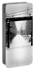 Portable Battery Charger featuring the photograph Winter Tracks by Aaron Berg