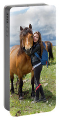 Woman Embracing Horse At Mountain Portable Battery Charger
