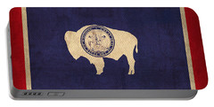 Wyoming State Flag Art On Worn Canvas Portable Battery Charger
