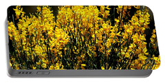 Portable Battery Charger featuring the photograph Yellow Cluster Flowers by Matt Harang