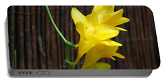 Portable Battery Charger featuring the photograph Yellow Petals by HEVi FineArt