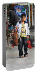 Young Boy Carrying A Dead Chicken To School Portable Battery Charger