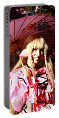 Portable Battery Charger featuring the photograph Young Girl At Cherry Blossom Festival by Dora Sofia Caputo Photographic Art and Design