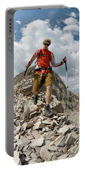 Young Man Hiking On Rocky Peak, San Portable Battery Charger