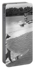 Young Woman Slalom Water Skis Portable Battery Charger