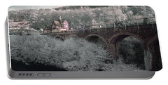 Portable Battery Charger featuring the photograph  Infrared Train Station Bridge by Beverly Cash