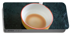 A Cup With The Remains Of Tea On A Green Table Portable Battery Charger by Ashish Agarwal
