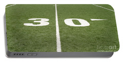 Portable Battery Charger featuring the photograph Football Field Thirty by Henrik Lehnerer