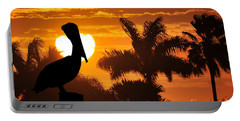 Portable Battery Charger featuring the photograph Pelican At Sunset by Dan Friend