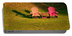 Portable Battery Charger featuring the photograph Red And Orange Chairs by Les Palenik