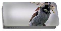 Portable Battery Charger featuring the photograph A Bird And A Twig by Elizabeth Winter