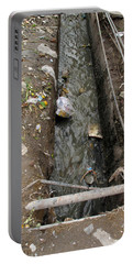 Portable Battery Charger featuring the photograph A Dirty Drain With Filth All Around It Representing A Health Risk by Ashish Agarwal