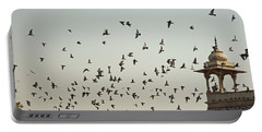 A Flock Of Pigeons Crowding One Of The Structures On Top Of The Red Fort Portable Battery Charger by Ashish Agarwal