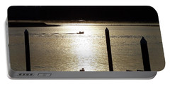 A Lone Boat At Sunset Portable Battery Charger