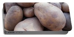 A Pile Of Large Lumpy Raw Potatoes Portable Battery Charger by Ashish Agarwal
