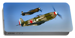 A Soviet Yakovlev Yak-3 And A P-51a Portable Battery Charger by Scott Germain