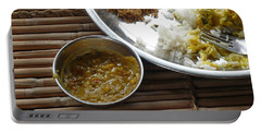 A Typical Plate Of Indian Rajasthani Food On A Bamboo Table Portable Battery Charger by Ashish Agarwal