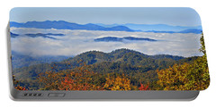 Portable Battery Charger featuring the photograph Above The Clouds by Susan Leggett