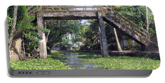 An Old Stone Bridge Over A Canal In Alleppey Portable Battery Charger