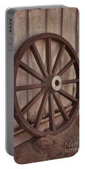 An Old Wagon Wheel Portable Battery Charger