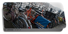 Portable Battery Charger featuring the digital art Bikes In Amsterdam by Carol Ailles