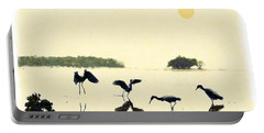 Portable Battery Charger featuring the photograph birds feeding in the Everglades by Dan Friend