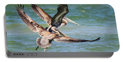 Brown Pelicans Taking Flight Portable Battery Charger