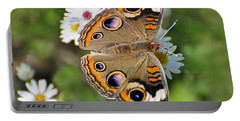 Buckeye Butterfly Portable Battery Charger by Rodney Campbell
