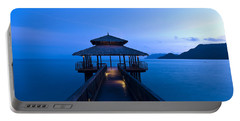 Building At The End Of A Jetty During Twilight Portable Battery Charger