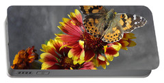 Portable Battery Charger featuring the photograph Butterfly On A Gaillardia by Verana Stark