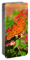 Portable Battery Charger featuring the photograph Butterfly On Pentas by Carla Parris