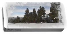 Cabin In Snow With Mountains In Background Portable Battery Charger