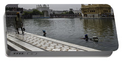 Portable Battery Charger featuring the photograph Clearing The Sarovar Inside The Golden Temple Resorvoir by Ashish Agarwal