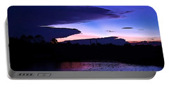 Portable Battery Charger featuring the photograph Clouded Sunset Over The Tomoka by DigiArt Diaries by Vicky B Fuller