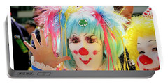 Portable Battery Charger featuring the photograph Cloverleaf Clown by Alice Gipson