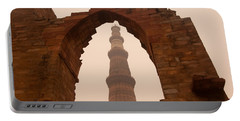 Cross Section Of The Qutub Minar Framed Within An Archway In Foggy Weather Portable Battery Charger
