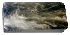 Portable Battery Charger featuring the photograph Dirty Clouds by Clayton Bruster